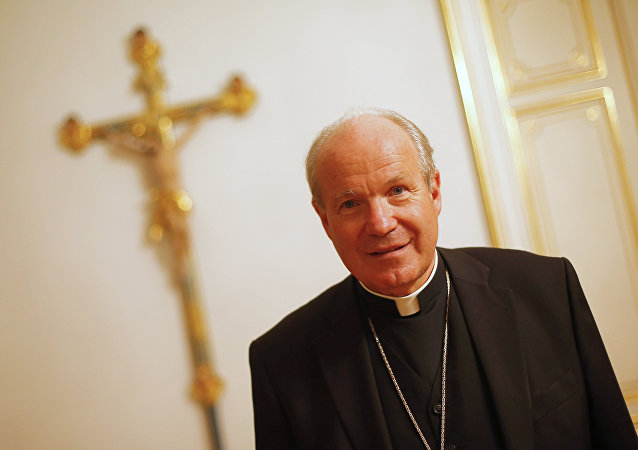 Austrian Cardinal Christoph Schoenborn, Archbishop of Vienna, poses for photo after a press meeting in Vienna on September 19, 2012.