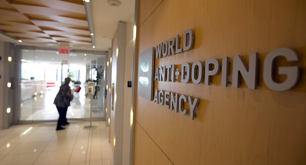 A woman walks into the head office of the World Anti-Doping Agency (WADA) in Montreal, Quebec, Canada November 9, 2015