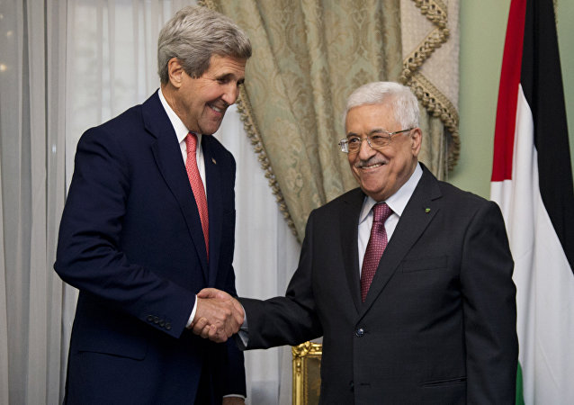 U.S. Secretary of State John Kerry shakes hands with Palestinian President Mahmoud Abbas at Andalus Villa in Cairo, Egypt, Sunday, Oct. 12, 2014