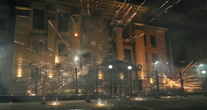Fireworks launched by protesters, explode near the Russian embassy.