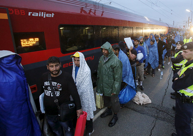 Migrants arrive at the Austrian train station of Nickelsdorf to board trains to Germany.