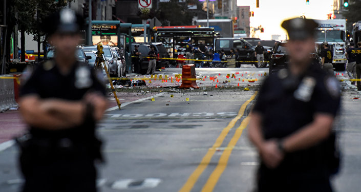 New York City Police Department (NYPD) officers stand near the site of an explosion in the Chelsea neighborhood of Manhattan, New York, U.S