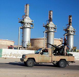 Libyan forces loyal to eastern commander Khalifa Haftar ride a pickup truck at the Zueitina oil terminal in Zueitina, west of Benghazi, Libya