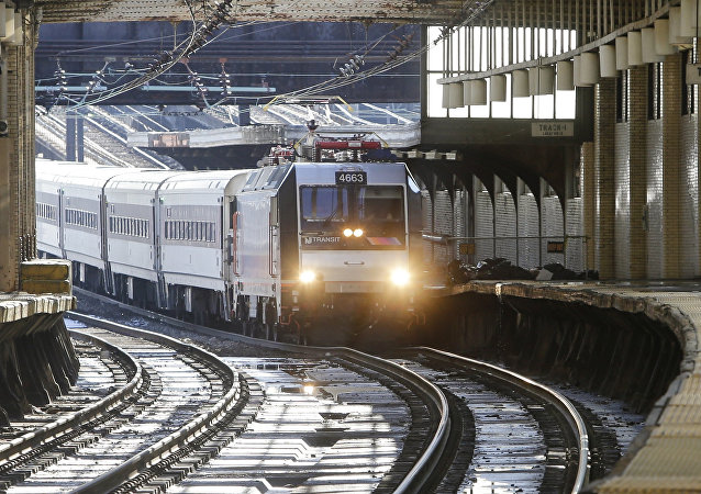 A train approaches the New Jersey Transit Newark Penn Station