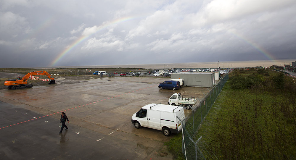 Rainbow over development land where the reactors of Hinkly C nuclear power station at Hinkley Point is supposed to be built on the west coast of England