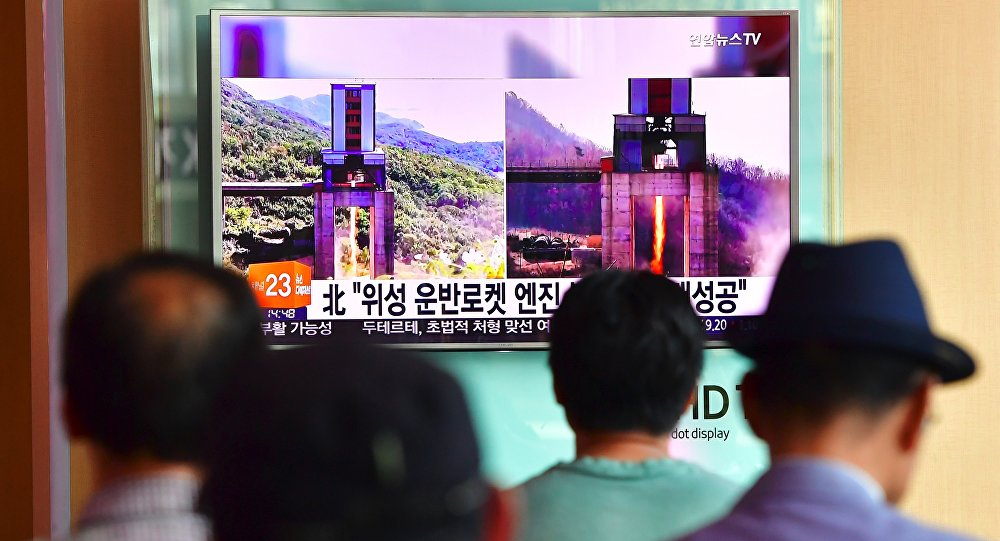 People watch a television news report about North Korea's latest ground test for a rocket engine, at a railway station in Seoul on September 20, 2016