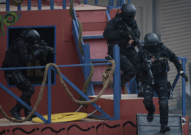 Malaysian Special Forces personnel demonstrate a hostage-rescue operation during the opening day of 15th Defence Services Asia Exhibition in Kuala Lumpur (File)