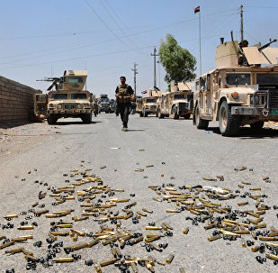 Shell casings lie on the ground as Iraqi government forces gather around the Qayyarah airbase, which was seized by Iraqi forces last week from jihadists of Daesh, on July 13, 2016, some 60 kilometres (35 miles) south of Mosul