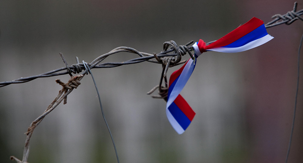 Barbed wire with a Russian flag