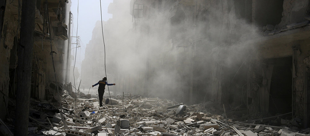 A man walks on the rubble of damaged buildings after an airstrike on the rebel held al-Qaterji neighbourhood of Aleppo, Syria September 25, 2016
