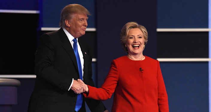 Democratic nominee Hillary Clinton (R) shakes hands with Republican nominee Donald Trump after the first presidential debate at Hofstra University in Hempstead, New York