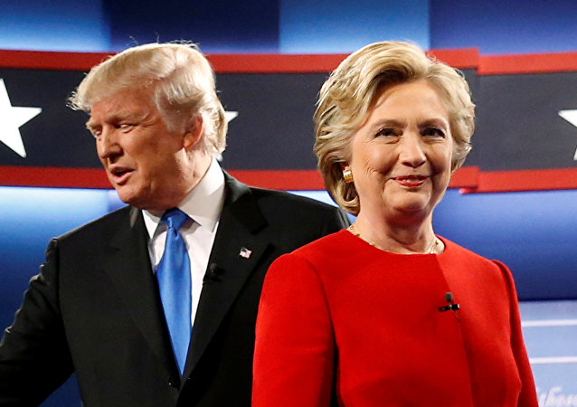 Republican US presidential nominee Donald Trump and Democratic U.S. presidential nominee Hillary Clinton greet one another as they take the stage for their first debate at Hofstra University in Hempstead, New York, U.S. September 26, 2016.