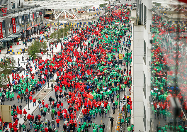 Trade Union members march through the streets during an anti-austerity demonstration in Brussels on October 7, 2015