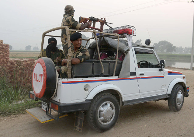 Indian Border Security Force (BSF) personnel patrol at the India-Pakistan border.