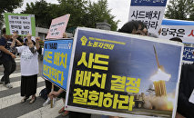 Protesters stage a rally to denounce deploying the Terminal High-Altitude Area Defense (THAAD) in front of the Defense Ministry in Seoul, South Korea, Wednesday, July 13, 2016