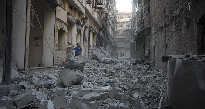 A Syrian man stands in the rubble of destroyed buildings following an air strike in Aleppo's rebel-controlled neighbourhood of Karm al-Jabal. (File)