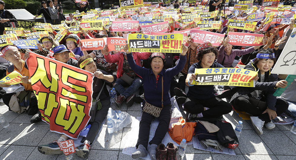 Residents in a rural South Korean town shout slogans to protest a plan to deploy an advanced US missile defense system called Terminal High-Altitude Area Defense, or THAAD, in their neighborhood, in Seoul, South Korea, Wednesday, Oct. 5, 2016.