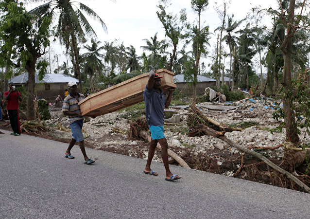 Men carry a coffin after Hurricane Matthew hit Cavaillon, Haiti, October 6, 2016