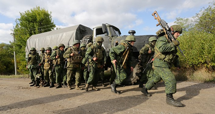 DPR militia forces leave their position during withdrawal in the village of Petrovske, some 50 km from Donetsk, on October 3, 2016