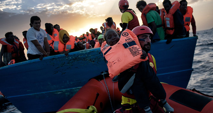 A child from African origin is rescued from a distressed vessel by a member of Proactiva Open Arms NGO in the mediteranean sea some 20 nautical miles north of Libya on October 3, 2016