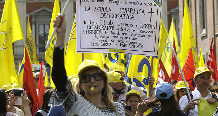Protestors march during a rally against the government's education reforms, in Rome (File)