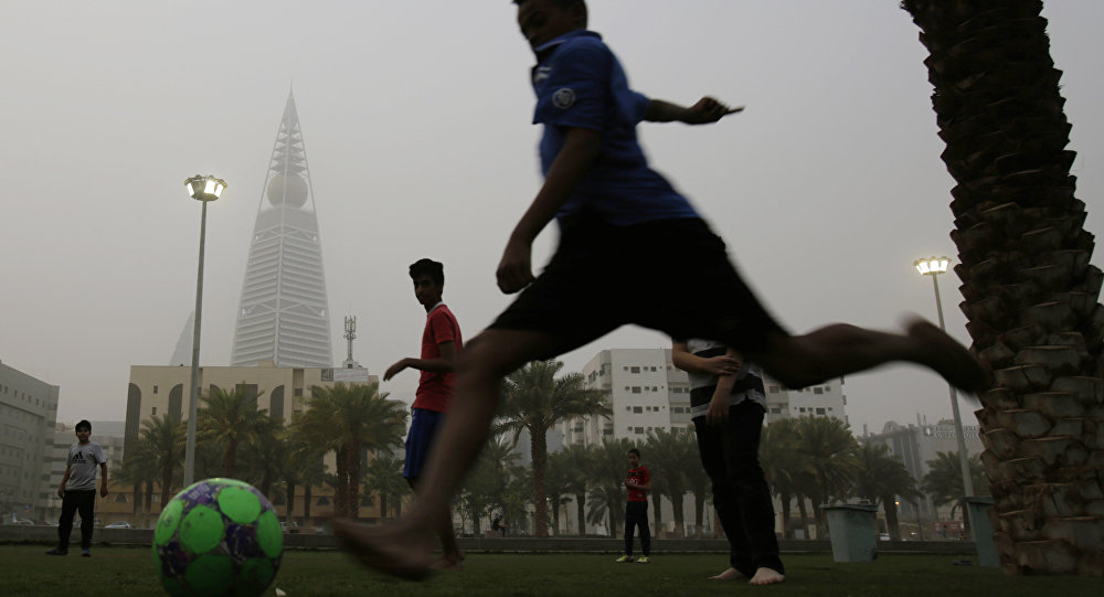 April 25, 2015. Saudi youths play soccer in a park during a dust storm in Riyadh, Saudi Arabia.