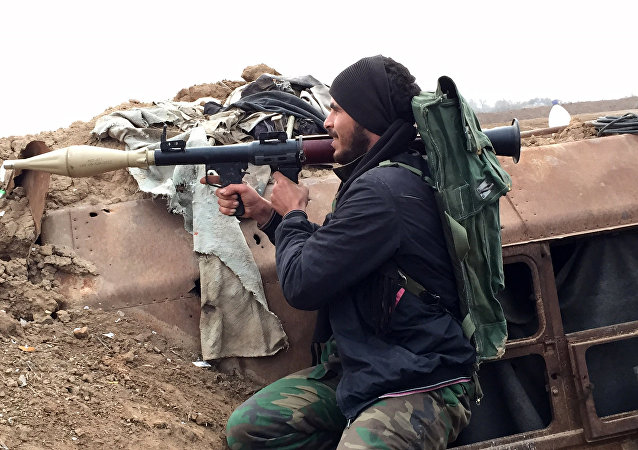 A pro-regime gunman holds a position in the northeastern Syrian city of Deir ez-Zor (File)