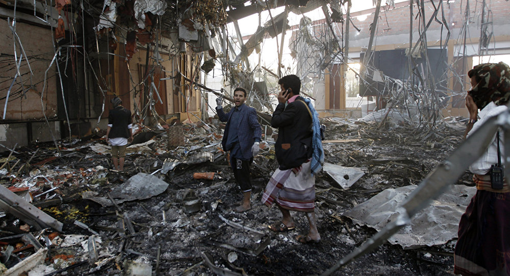 Yemeni rescue workers search for victims amid the rubble of a destroyed building following reported airstrikes by Saudi-led coalition air-planes on the capital Sanaa on October 8, 2016