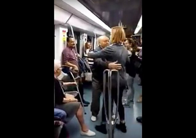 Elderly pair dances to rap music at Barcelona subway