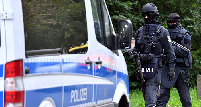 Policemen of a special unit are pictured at the Yorckgebiet district of Chemnitz, eastern Germany, where German police commandos hunting a fugitive Syrian bomb plot suspect raided a flat on October 9, 2016