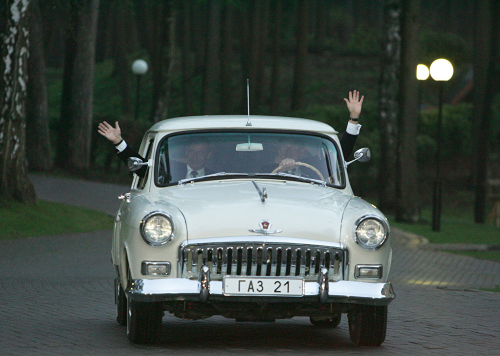President of Russia Vladimir Putin and Then-President of the US George W. Bush ride in Putin's vintage GAZ-21 Volga of the second series during their meeting in Novo-Ogarevo, a presidential country residence outside the capitol.