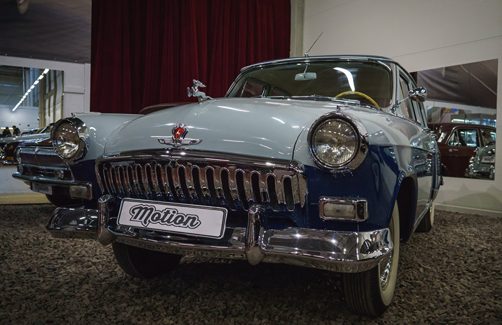 An exhibit at the antique car show held as part of the Motion project with support of the Moscow Museum of Retro Cars and collectors of retro vehicles in St. Petersburg. GAZ -21 of the second series, with a chrome deer on its hood.