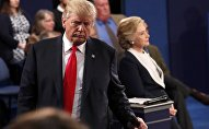 Republican U.S. presidential nominee Donald Trump and Democratic U.S. presidential nominee Hillary Clinton pause during their presidential town hall debate at Washington University in St. Louis, Missouri, U.S., October 9, 2016