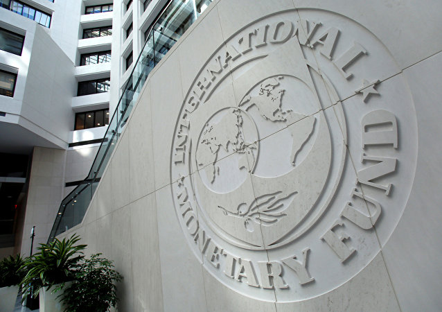 The International Monetary Fund logo is seen inside its headquarters.