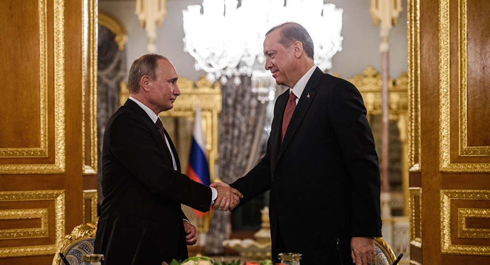 Russian President Vladimir Putin (L) shakes hand with Turkish President Recep Tayyip Erdogan (R) during a press conference on October 10, 2016 in Istanbul