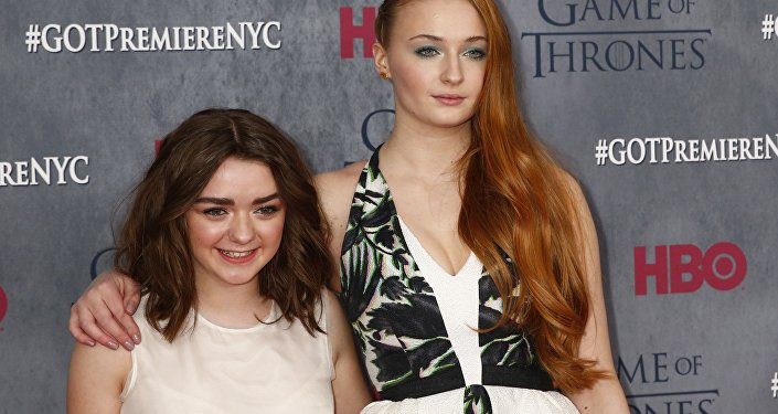 Cast members Maisie Williams and Sophie Turner arrive for the season four premiere of the HBO series Game of Thrones in New York March 18, 2014.