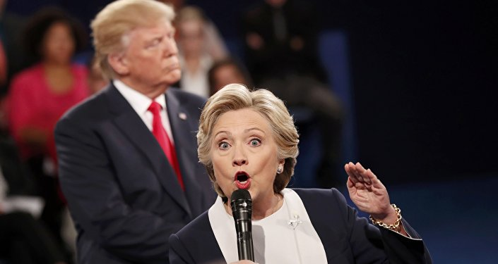 Democratic U.S. presidential nominee Hillary Clinton speaks during their presidential town hall debate with Republican U.S. presidential nominee Donald Trump at Washington University in St. Louis, Missouri, U.S., October 9, 2016.