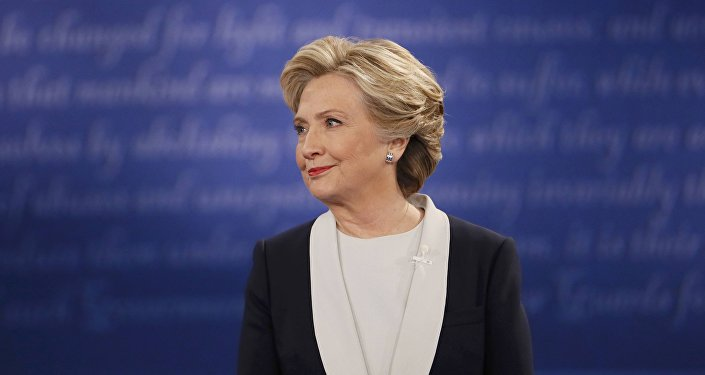 Democratic U.S. presidential nominee Hillary Clinton listens during their presidential town hall debate with Republican U.S. presidential nominee Donald Trump at Washington University in St. Louis, Missouri, U.S., October 9, 2016.