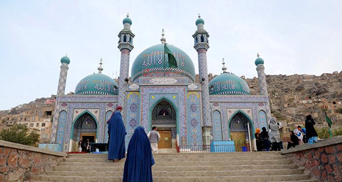 Afghan burqa-clad women visit The Karte Sakhi Shrine in Kabul
