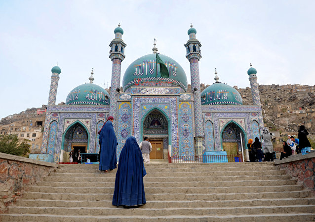 Afghan burqa-clad women visit The Karte Sakhi Shrine in Kabul