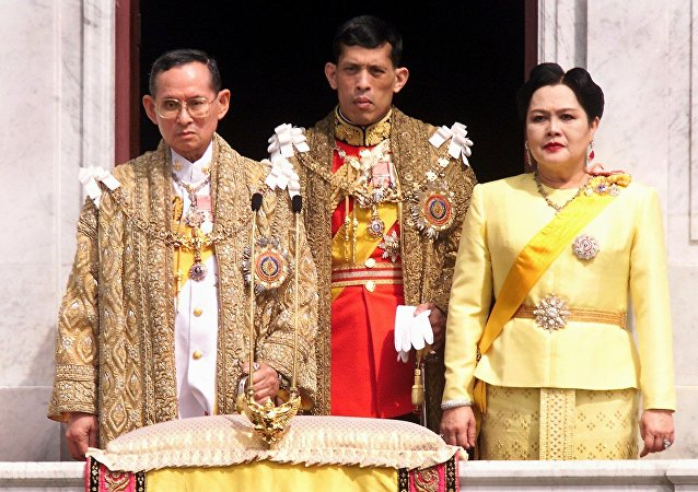 This file photo taken on December 05, 1999 shows (L-R) Thai King Bhumibol Adulyadej, Crown Prince Maha Vajiralongkorn and Queen Sirikit appearing at a balcony of Anantasamakom Throne Hall in Bangkok to mark the King's birthday.