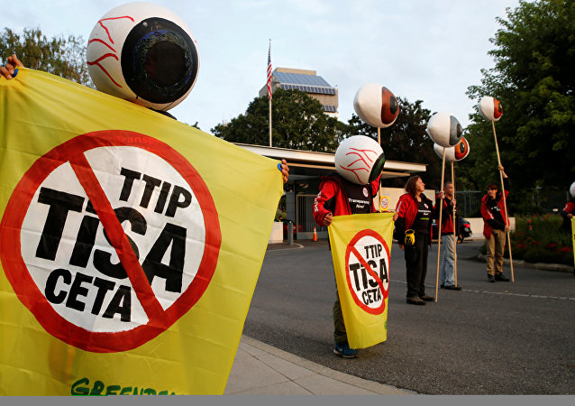 Greenpeace activists hold banners and giant eyes during a demonstration against the trade agreements TTIP, CETA and TiSA in front of the U.S. Mission in Geneva, Switzerland, September 20, 2016.