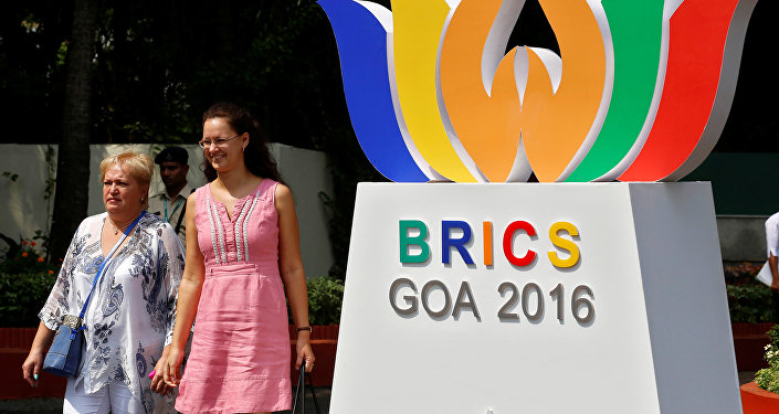 People walk out of one of the venues of BRICS (Brazil, Russia, India, China and South Africa) Summit, in Benaulim, in the western state of Goa, India, October 14, 2016.