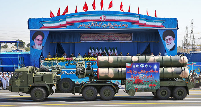 In front of the portraits of supreme leader Ayatollah Ali Khamenei, right, and late revolutionary founder Ayatollah Khomeini, left, a long-range, S-300 missile system is displayed by Iran's army during a military parade marking the 36th anniversary of Iraq's 1980 invasion of Iran, in front of the shrine of late revolutionary founder Ayatollah Khomeini, just outside Tehran, Sept. 21, 2016