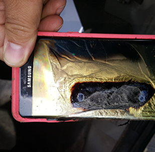 This Friday, Oct. 7, 2016, photo provided by Andrew Zuis, of Farmington, Minn., shows the replacement Samsung Galaxy Note 7 phone belonging to his 13-year-old daughter Abby, that melted in her hand earlier in the day