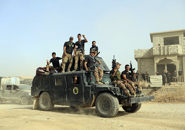 FILE -- In this Saturday, Oct. 15, 2016, file photo, Iraq's elite counterterrorism forces gather ahead of an operation to re-take the Islamic State-held City of Mosul, outside Irbil, Iraq