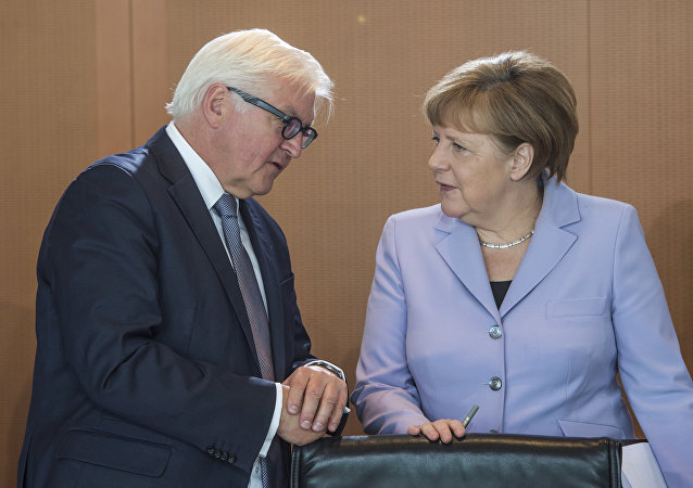 German Chancellor Angela Merkel (R) chats with German Foreign Minister Frank-Walter Steinmeier as she arrives for a weekly meeting of the German cabinet at the chancellery in Berlin on May 11, 2016