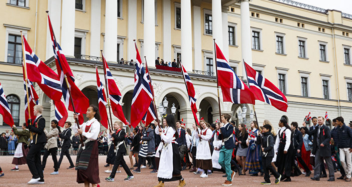 Children take part in a parade to celebrate Norway's Independence Day outside the Castle in Oslo