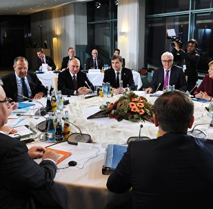 Russian President Vladimir Putin, German Chancellor Angela Merkel, background 2nd right, and Ukrainian President Petro Poroshenko, foreground right, during the Normandy format meeting between the leaders of Germany, Russia, Ukraine and France on settling the Ukrainian conflict, at the Paul Loebe Haus parliamentary building in Berlin, October 19, 2016. Background 3rd right: German Foreign Minister Frank-Walter Steinmeier. Background left: Russian Foreign Minister Sergei Lavrov. Background 3rd left: Russian Presidential Aide Vladislav Surkov.