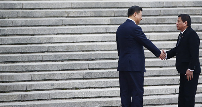President of the Philippines Rodrigo Duterte (R) and Chinese President Xi Jinping shake hands as they attend a welcoming ceremony at the Great Hall of the People in Beijing, China, October 20, 2016.